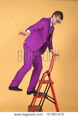 Stylish man falling off a ladder