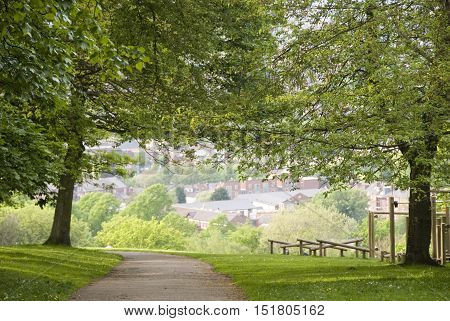 Sheffield, UK 03 05 2014: Pathway through trees overlooking the city on 03 May 2014 at Meersbrook Park, Sheffield, UK