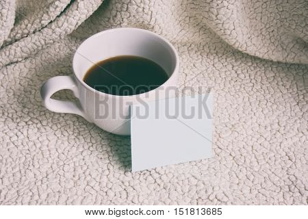A Cup Of Coffee, A Note Near The Cup, The Cup On A White Background
