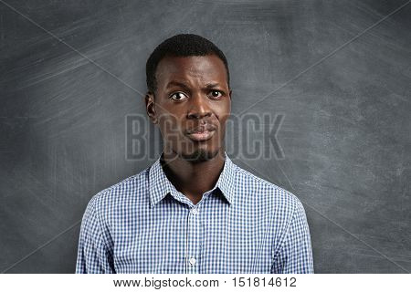Shocked Dark-skinned Teacher Surprised With His Pupils Misbehavior During His First Day At School. A