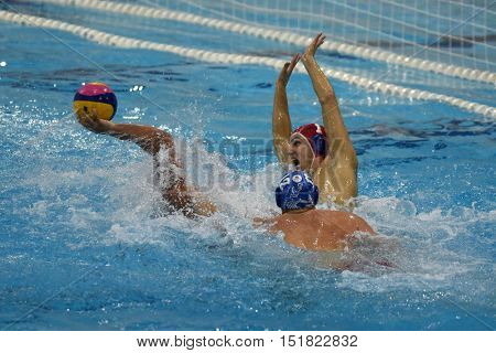 KAPOSVAR, HUNGARY - OCTOBER 5: Attila Decker (in red) in action at a Hungarian national championship water-polo game between Kaposvar (white) and Honved (blue) on October 5, 2016 in Kaposvar, Hungary
