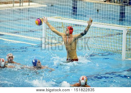 KAPOSVAR, HUNGARY - OCTOBER 5: Balazs Kremer (in red) in action at a Hungarian national championship water-polo game between Kaposvar (white) and Honved (blue) on October 5, 2016 in Kaposvar, Hungary
