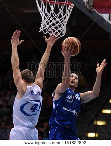 KAPOSVAR, HUNGARY - OCTOBER 6: Austin Dufault (in blue) in action at Hungarian Championship basketball game with Kaposvar (white) vs. Sopron (blue) on October 6, 2016 in Kaposvar, Hungary.