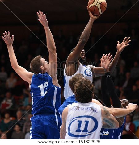 KAPOSVAR, HUNGARY - OCTOBER 6: Malik Cooke (with ball) in action at Hungarian Championship basketball game with Kaposvar (white) vs. Sopron (blue) on October 6, 2016 in Kaposvar, Hungary.