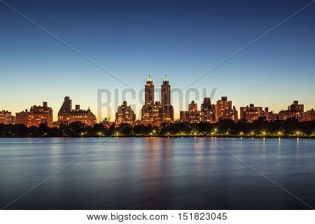 Upper West Side buildings and Central Park Jacqueline Kennedy Onassis Reservoir at twilight. Manhattan, New York City