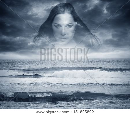 Silhouette of woman's face on the background of the storm sea.