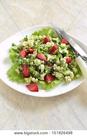 Tabbouleh with strawberries bulgur and vegetables, vertical