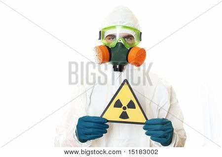 Man in protective suit, a mask and a respirator. Holding a sign warning of radiation. Isolated on white poster