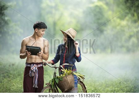 Couple young farmer in rice green field
