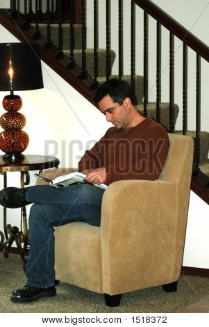 Man Reading In His Favorit Chair