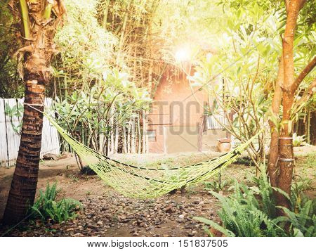 Lazy time with hammock in the summer garden