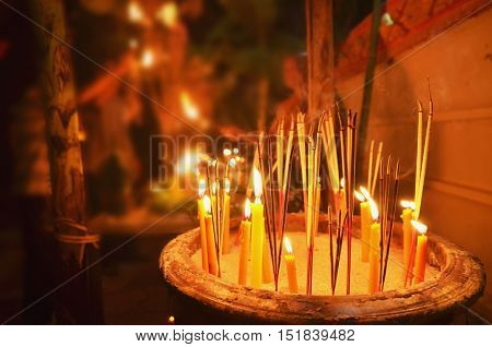 lighting candles to worship the Buddha on the end of Buddhist Lent festival