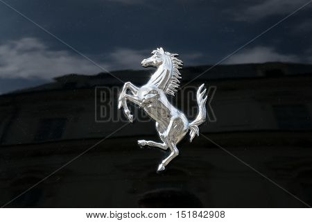 TURIN, ITALY - JUNE 9, 2016: Ferrari prancing horse on a black car body