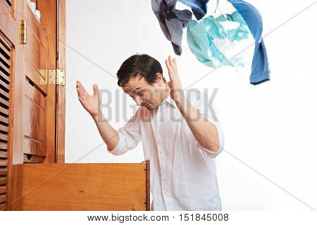 Man Throwing Clothes