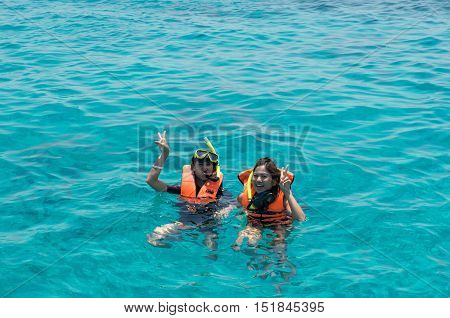 Pang-nga, Thailand - Mar 3, 2015: Two Women Tourists Were Floating In The Andaman Sea