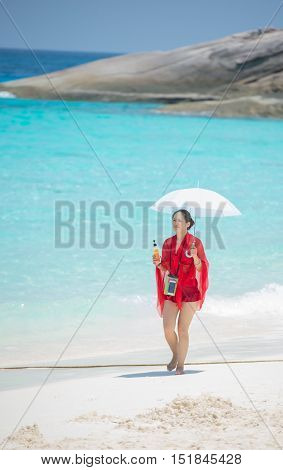 Pang-nga, Thailand - Mar 3, 2015: Girl Tourists Holding Umbrella Walk On Koh Similan