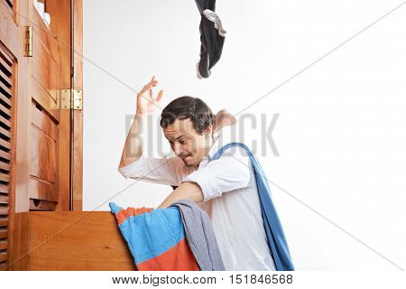 Man Throwing Clothes In Air