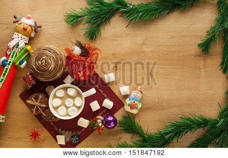 christmas cocoa with marshmallow and homemade cookies with chocolate and nuts, free space on the right side. New year hot drink. Merry Christmas evening beverage.