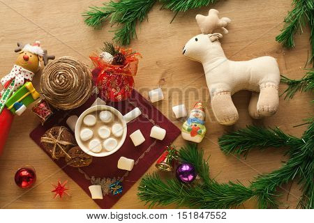 Christmas cocoa with marshmallow and homemade cookies with chocolate and nuts, with decorations and deer. New year hot drink. Merry Christmas evening beverage.
