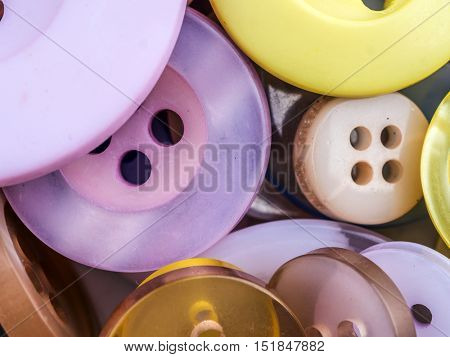 Pile of apparel buttons in different size and colors shot from above