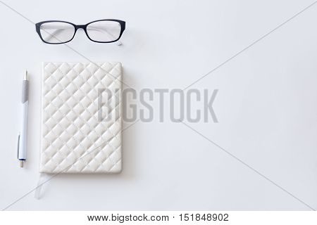 High angle view image of a half- empty working desk, lady office supplies. Close up, education concept photo, copyspace