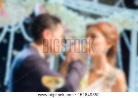 blurred Couple lover with arms crossed to drink wine in wedding ceremony