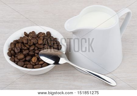 Coffee Beans In Bowl, Teaspoon And Milk Jug