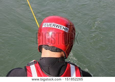 Helmet of a professional fire brigade during an exercise in a river