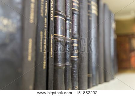 Row of old book in a bookcase 2