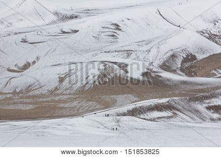 Snow adds to the tourist attraction of the tallest dunes in North America at Great Sand Dunes National Park and Preserve in Colorado's San Luis Valley. Date is May 27 2016.