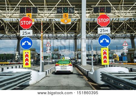ST. PETERSBURG RUSSIA - AUG 13 2015: Cars passing through the point of toll highway toll station. Russian highway August 13 2015 in St. Petersburg Russia