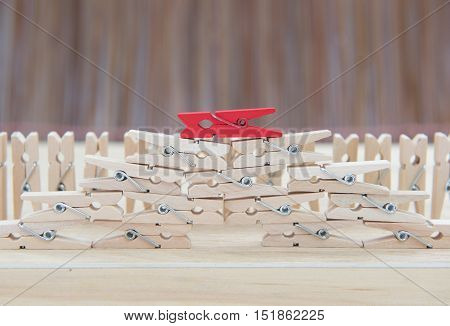 Wooden Clothes Pin ,selective Focus Point On Red Leader