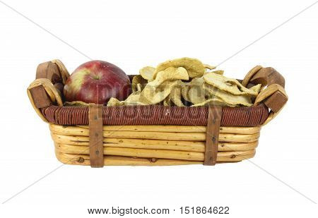 Fresh red apple and dehydrated slices in a wicker basket with a clipping path at original size