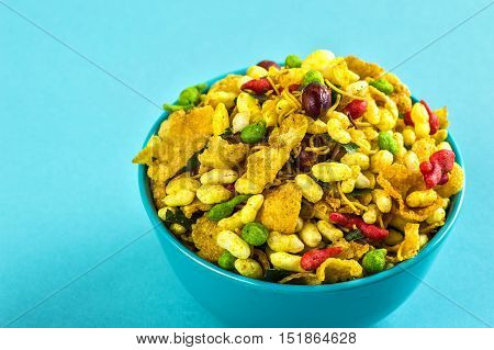 Indian Snacks: Traditional Indian deep fried salty dish called chivda or mixture or farsan made of gram flour and mixed with dry fruits and roasted nuts with salt, pepper, pulses, spice and green peas poster