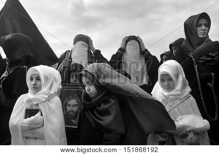 Istanbul Turkey - November 3 2014: Ashura Mourning sad people at the event. Day of Ashura. A Universal Ashura Mourn Ceremony was held in Istanbul to commemorate the martyrdom of Husain ibn Ali the grandson of the Prophet Muhammad and his 71 friends.