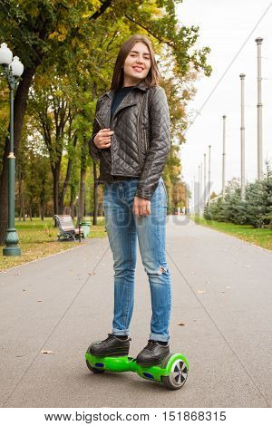 Young  Woman Riding Hoverboard - Electrical Scooter, Personal Eco Transport.