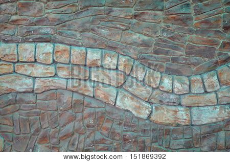 The texture of the wall lining of the processed wild stone of two colors .