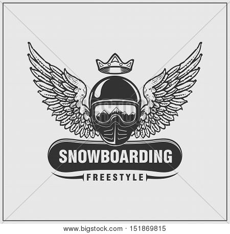 Label and emblem of snowboarding. Ski helmet with a crown and wings. Vector monochrome design.