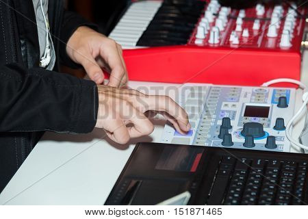 Hands on mixing desk console close up view