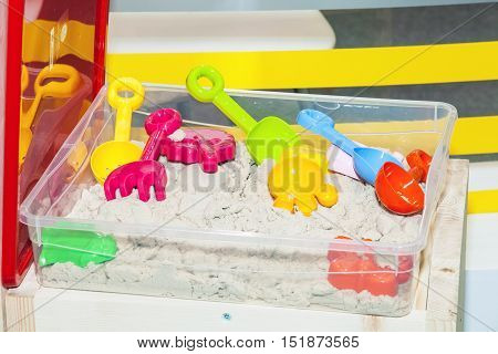 Kinetic sand toy with colorful sand molds