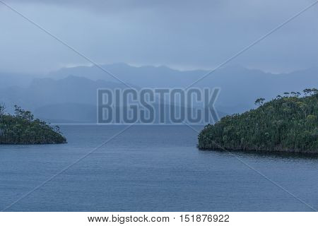 Tranquil Evening On Lake Pedder With Beautiful Hills Silhouetted Above Calm Waters. Southwest, Tasma