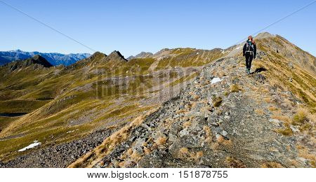 Woman Hiking Along A Mountain Ridge.  Nelson Lakes National Park, Southern Alps, New Zealand
