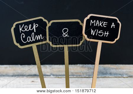 Keep Calm And Make A Wish Message Written With Chalk On Mini Blackboard Labels