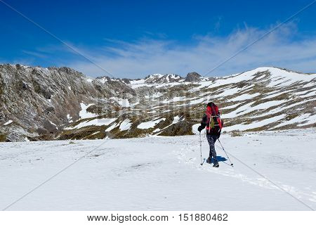 A Woman Hiking In the Snowy Southern Alps.  Lake Angelus Route, Nelson Lakes National Park, New Zealand
