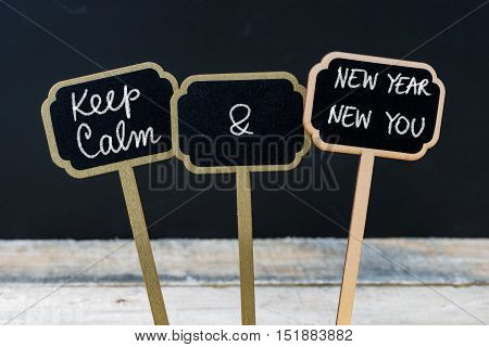 Keep Calm And New Year New You Message Written With Chalk On Mini Blackboard Labels