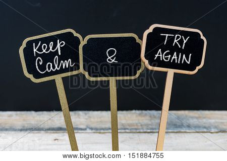 Keep Calm And Try Again Message Written With Chalk On Mini Blackboard Labels