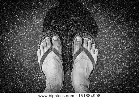 Black And White Of Top View Feet In Sandals Selfie Shot Of Asian Men Legs With Wet Street