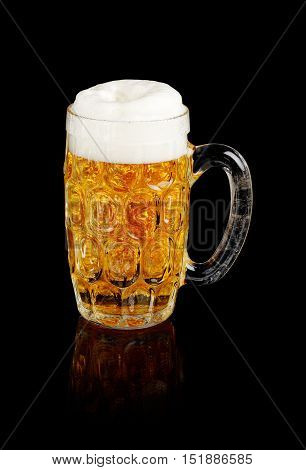 Beer stein with foamy beer reflectedin a black background.