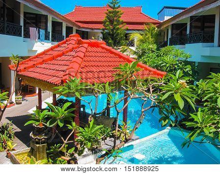 Kuta, Bali, Indonesia - April 09, 2012: View of swimming pool at The Flora Kuta Bali