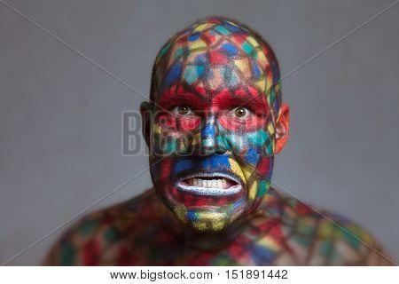 Furious villain portrait colorful face art with tilt shift and motion blur effect.